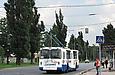ЗИУ-682 #866 63-го маршрута на проспекте Героев Сталинграда за перекрестком с улицей Морозова подъезжает к...