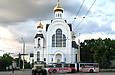 КрАЗ-260 и ЗИУ-683В00 #3104 40-го маршрута разворачиваются на перекрестке проспекта Ленина и улицы Деревянко.